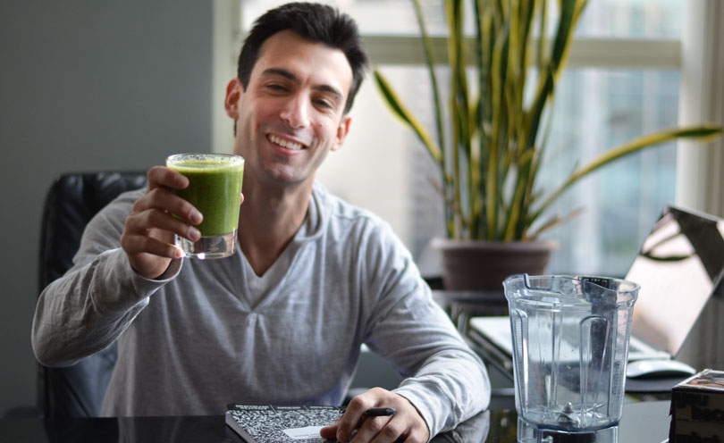 Lenny Gale with green smoothie and notebook