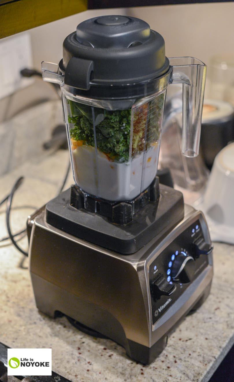 Apple carrot kale smoothie ingredients in a Vitamix Pro 750 and 32 ounce container.