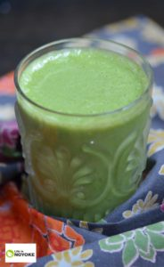 Pretty vertical picture of an apple carrot kale green smoothie.