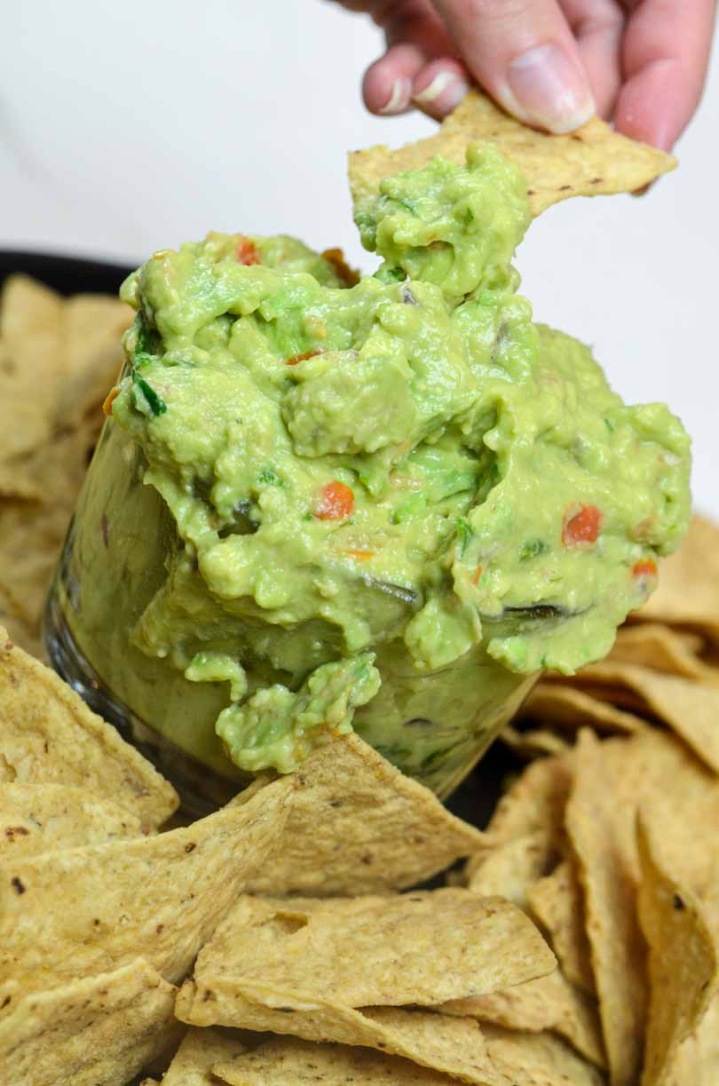 Chip full of guacamole.