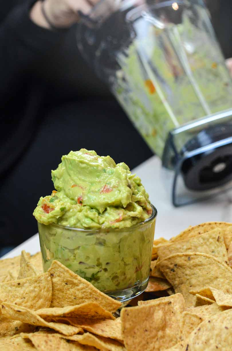Guacamole scooped from a Vitamix container.