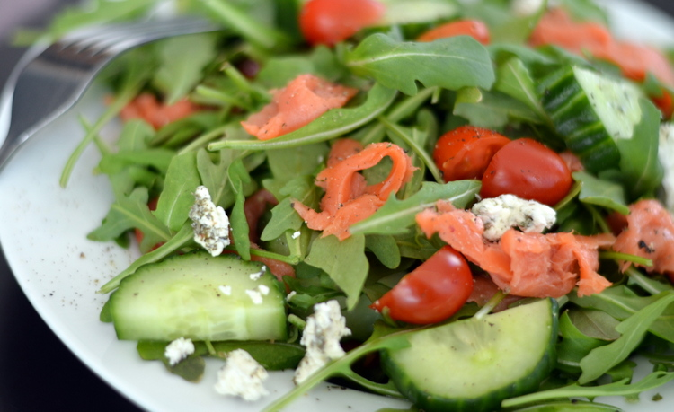 Salmon salad with arugula, goat cheese, cucumbers, and tomatoes. Easy ...