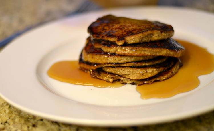 Hot finished matzah pancakes on white plate with maple syrup