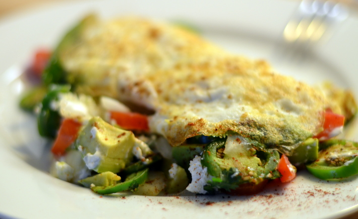 ... egg white omelet served with jalapenos onions and goat cheese
