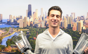 Lenny Gale with two Vitamix containers in front of Chicago view