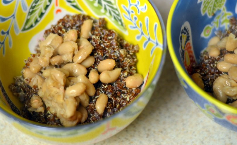 VIew of bowl after adding beans to quinoa.