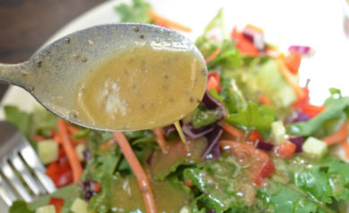 Spoonful of chia seed dressing made in a Vitamix.