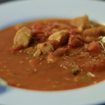 Cioppino served in white bowl