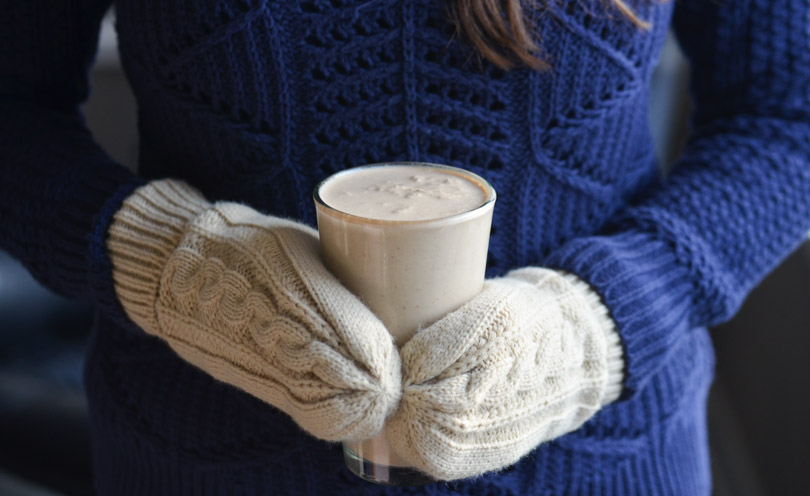 Chiberia chiller held by Shalva with white mittens over blue sweater.