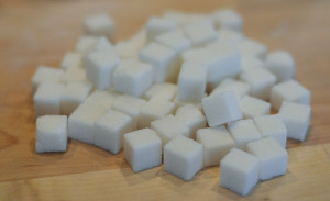 64 small sugar cubes. 1 cm on each side.