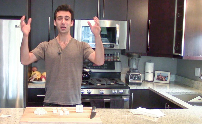 Lenny Gale in kitchen using sugar cubes to explain why food particle size matters for better tasting food.