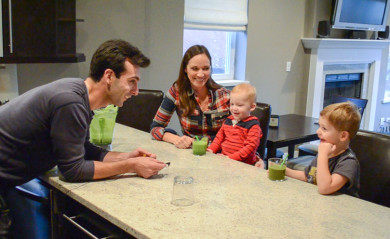 Lenny Gale serving his neighbors' kids vegetables via a green smoothie.