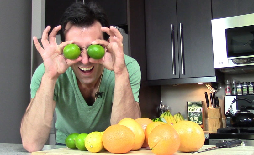 Lenny Gale limes on his eyes demonstrating how to slice citrus fruits.