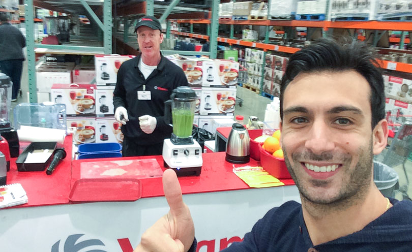 Lenny Gale posing in with a Vitamix demonstration at Costco.
