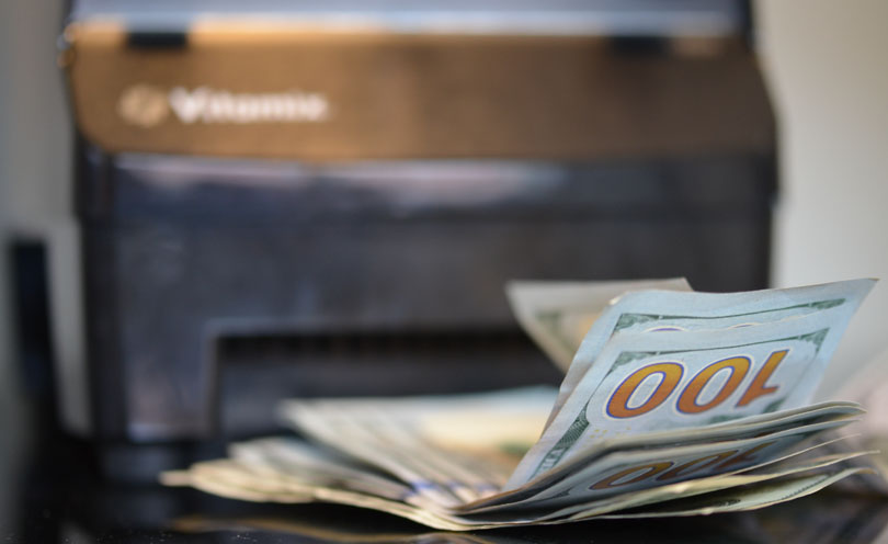 Vitamix Payment Plan illustrated with a 5200 model and hundred dollar bills.