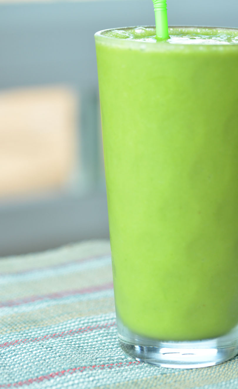 Carolynes green smoothie tall glass.
