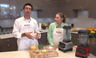 Lenny Gale learns the technique for making green smoothies in a Vitamix.