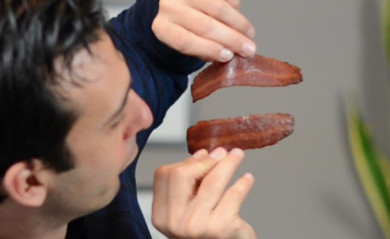 Lenny Gale playing with bacon for a video on getting cancer from red and cured meats.