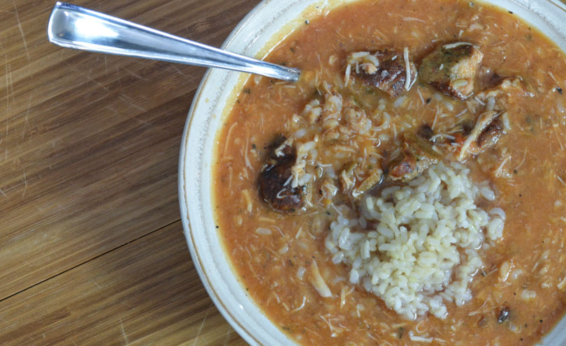 Louisiana gumbo served in a white bowl.