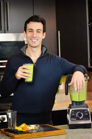 Lenny Gale with a green smoothie and his Vitamix Pro 750.