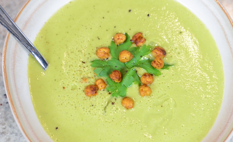 Zucchini coconut soup served with roasted chickpeas.