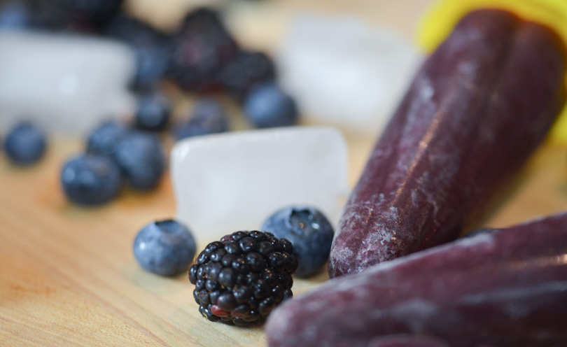 Two blueberry blackberry popsicles served.