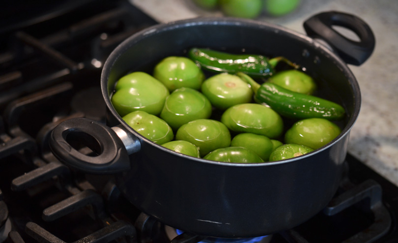Boiling tomatillos and jalapenos to make Zvi's smoky salsa.