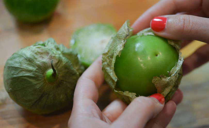 Peeling the tomatillos by hand.
