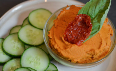 Sun dried tomato basil hummus served with cucumbers.