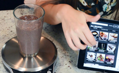 Chocolate blueberry smoothie being measured by a Perfect Blend Smart Scale.