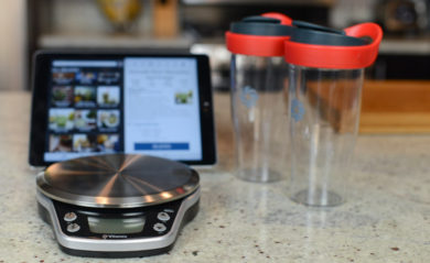 Vitamix Perfect Blend Scale and Interactive Recipe App with ipad and two smoothie cups.