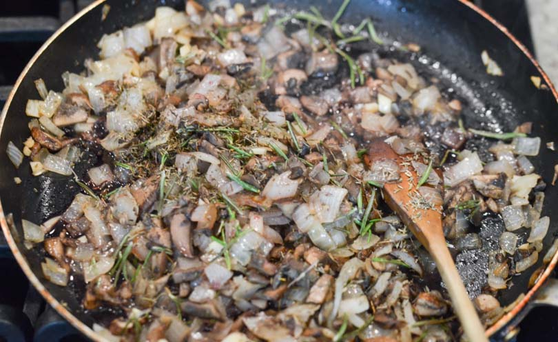 Mushrooms and onions sauteeing.