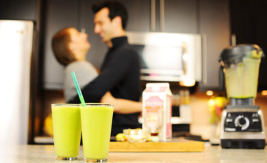 Lenny and Shalva Gale hugging in background of two smoothies and a Vitamix.