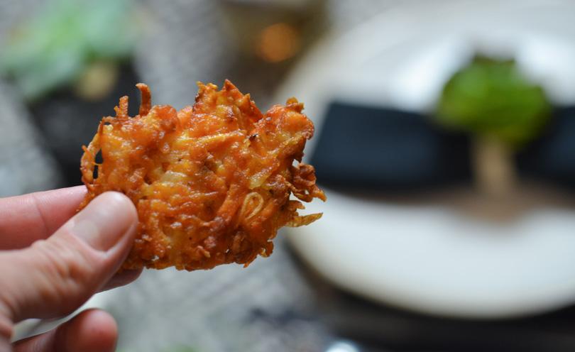 A sweet potato latke up close in my finger tips.