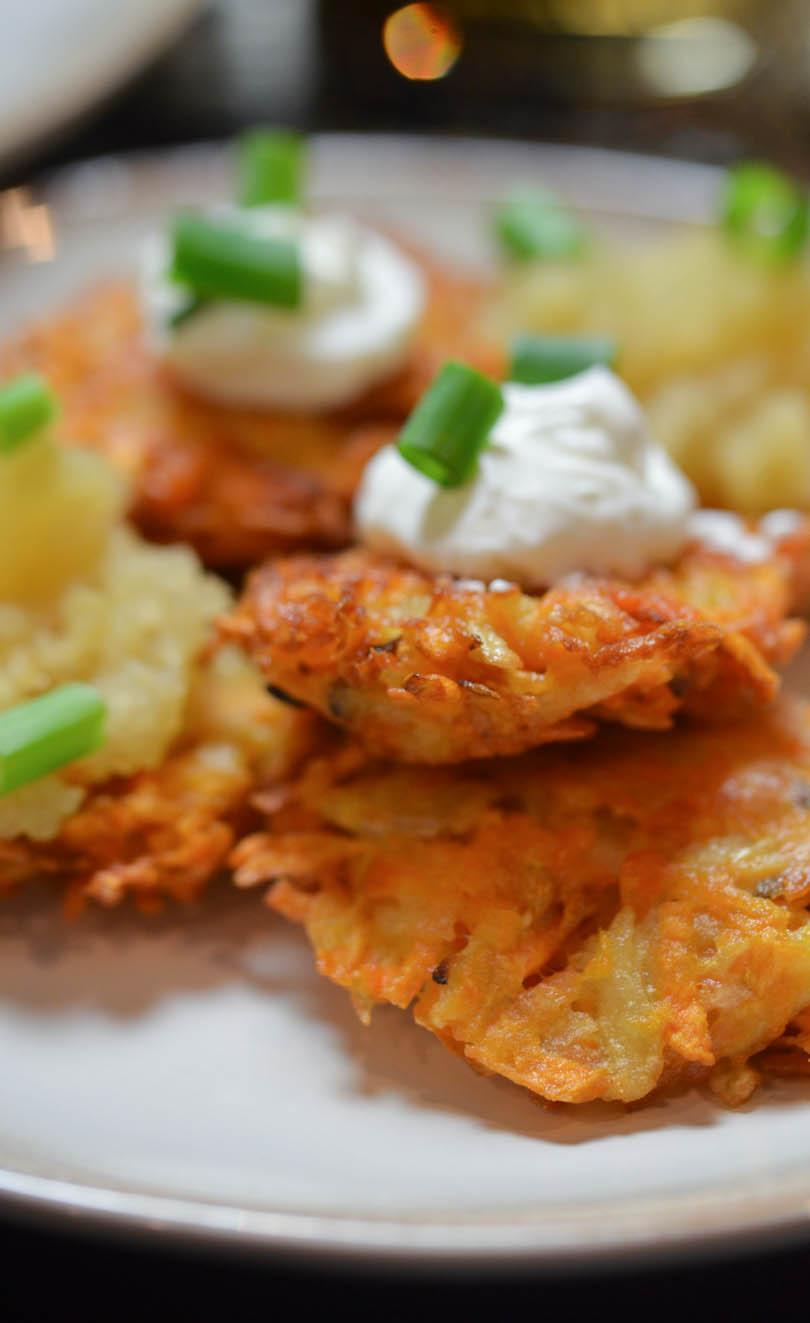 Sweet potato latkes with sour cream on top.
