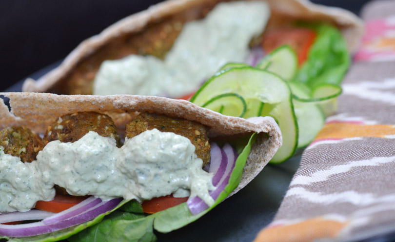 Tzatziki on a falafel sandwich.