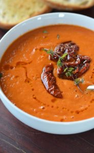 Tomato soup garnished with sun-dried tomato and thyme.