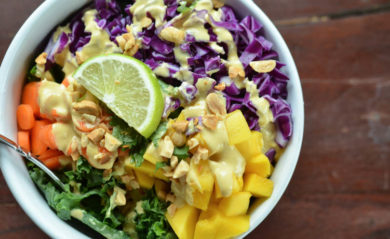 Thai coconut curry dressing served on kale carrot mango cabbage salad.