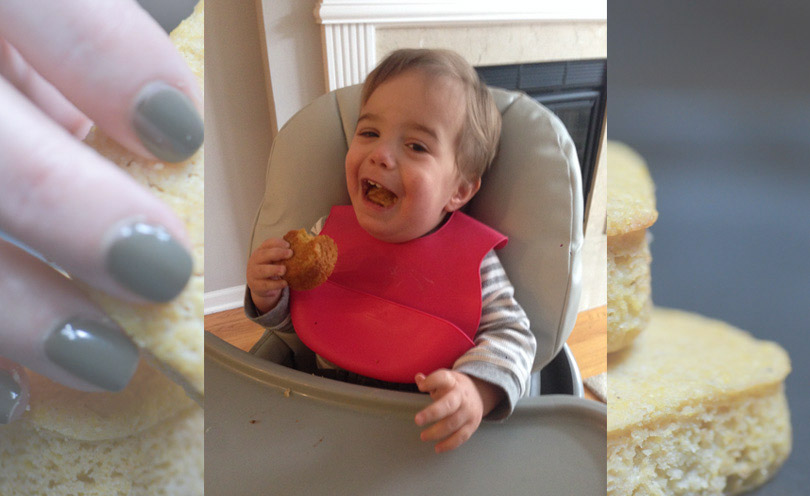 Baby Avi in his highchair enjoying some of Life is NOYOKE's cornbread.