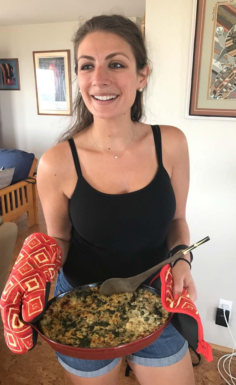 Shalva serving her artichoke dip