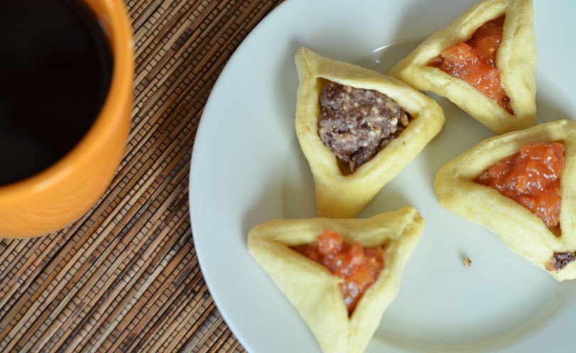 Vegan hamentashen with a cup of coffee