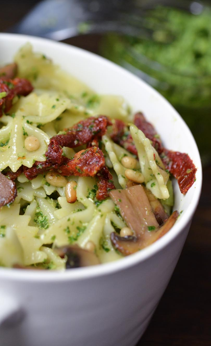 Pesto-covered pasta with sun-dried tomato and mushrooms.