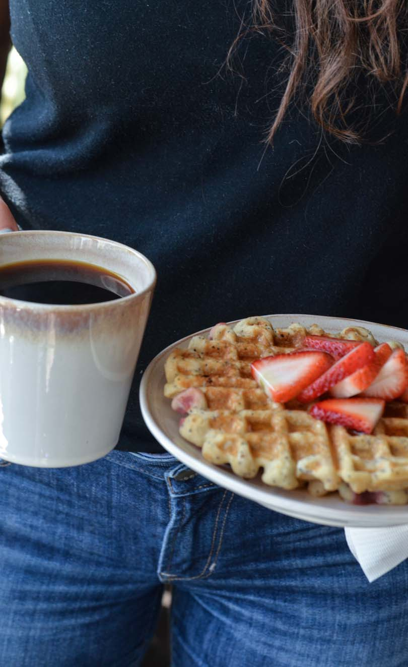 Waffles served with coffee.