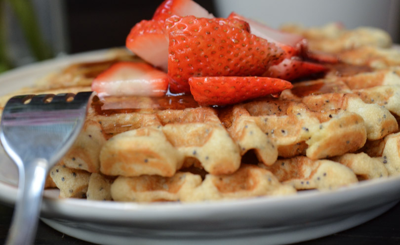 Waffles with strawberries on top by Life is NOYOKE.