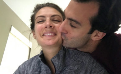 Lenny kissing Shalva on the cheek.