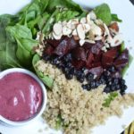Blueberry vinaigrette served with a spinach and beet and quinoa salad.