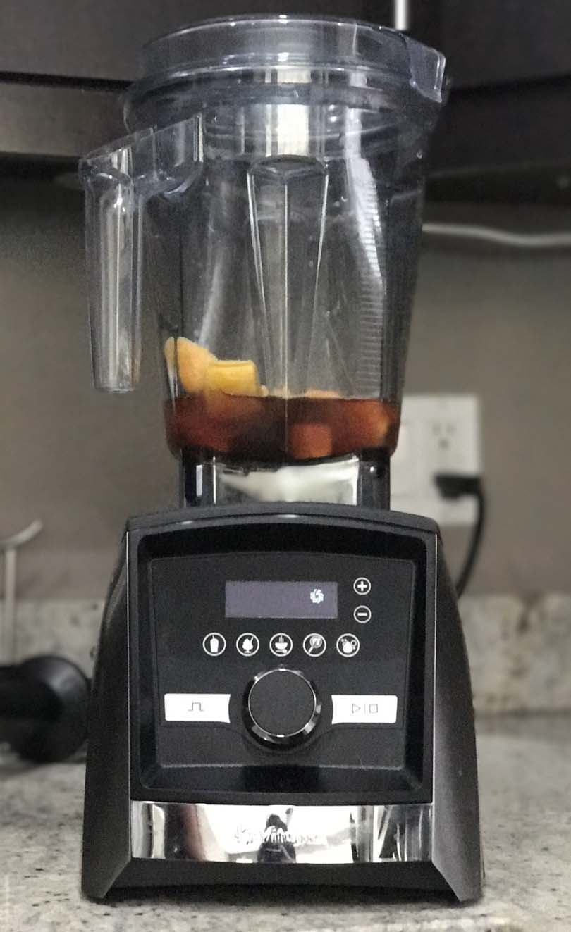 Vitamix A3500 with small batch of black tea mango smoothie ingredients.