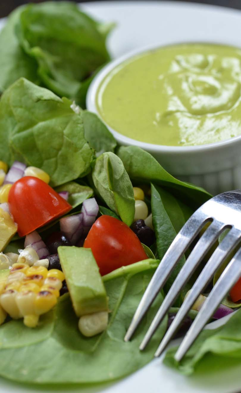 Mango dressing on a spinach salad with roasted corn.