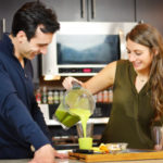 Shalva and Lenny Gale with green juice and a Vitamix.