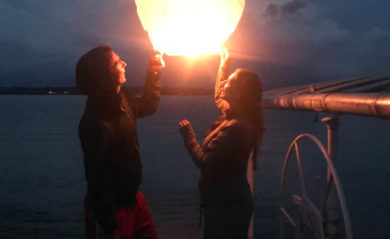 Lenny and Shalva with a wish lantern at the lake in 2017.
